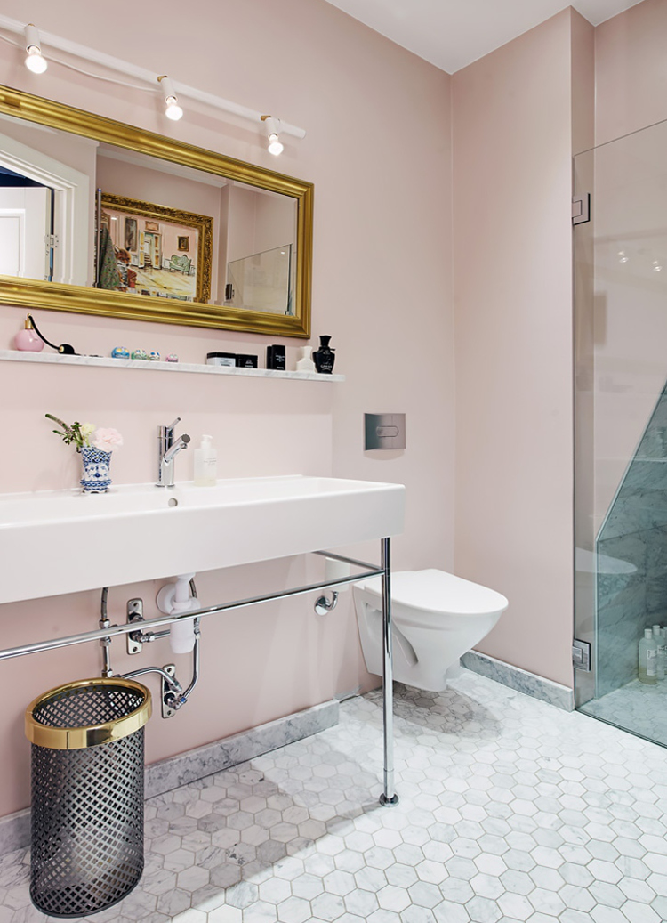 modern pink bathroom - white Duravit console sink and wall-hung toilet in a Swedish apartment bath - AlvhemMakleri.se via Atticmag