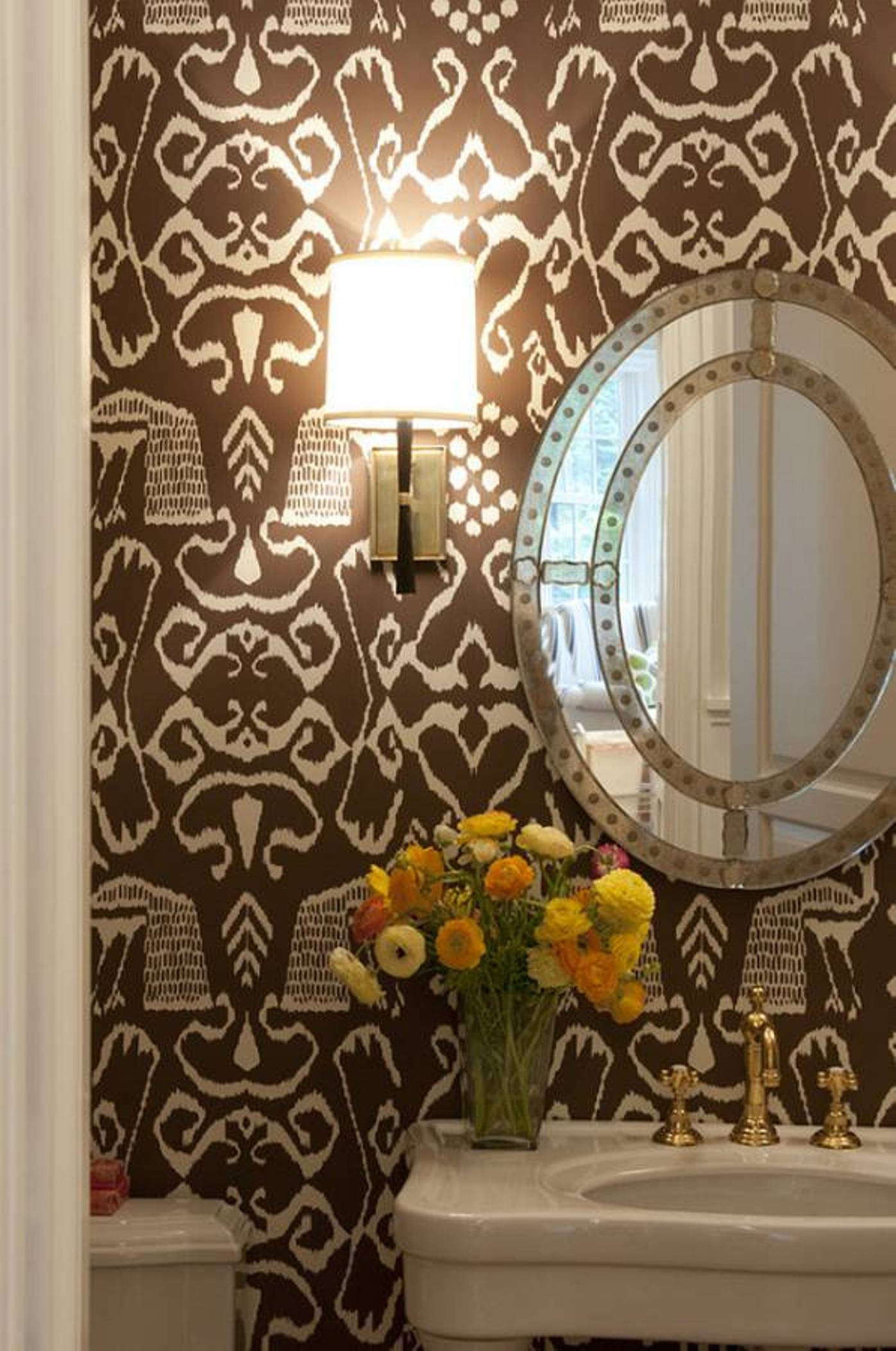 bathroom wallpaper - China Seas Bali II in brown in a powder room - Julie Nightingale Design via Atticmag
