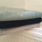 buying bath towels - Coyuchi Twill Weave Air Weight towels in mid dusty aqua, midnight and fog - Atticmag