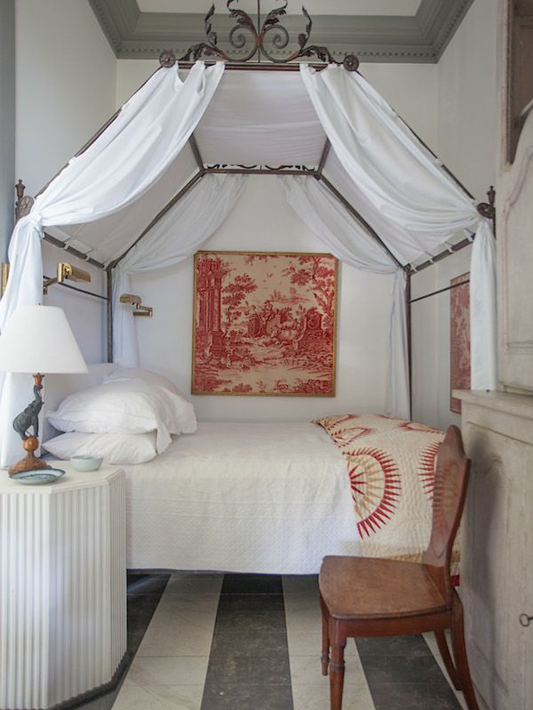draped canopy beds - iron frame canopy bed, draped in white, in Furlow Gatewood's Georgia guest cottage - Veranda via Atticmag