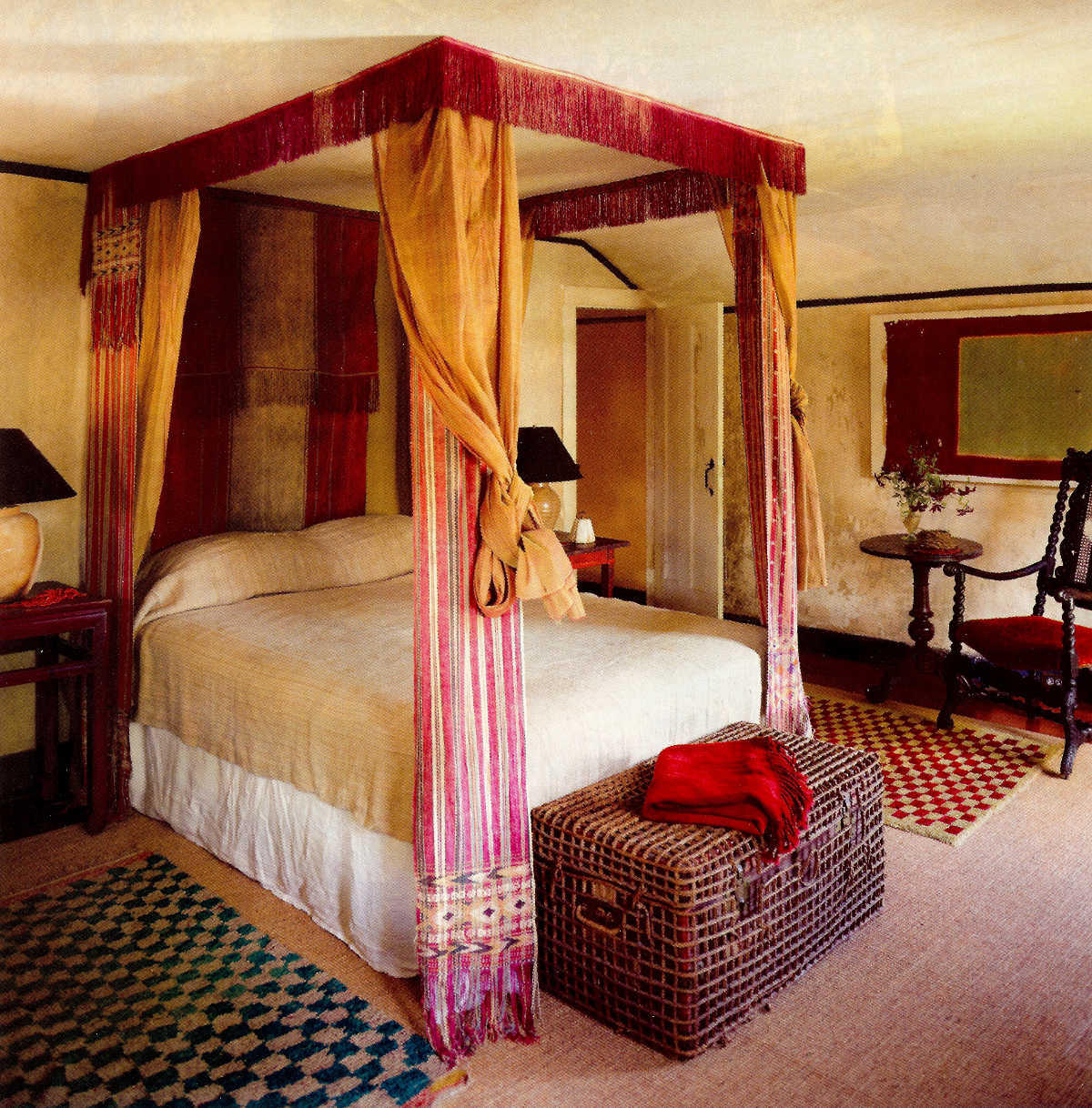draped canopy beds - Four poster canopy bed draped in antique Asian textiles - Elle Decor via Atticmag