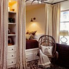 Pullman beds - built in back to back twin beds in alcoves with curtains in a brown and white guest room - Phoenix Home & Garden via Atticmag