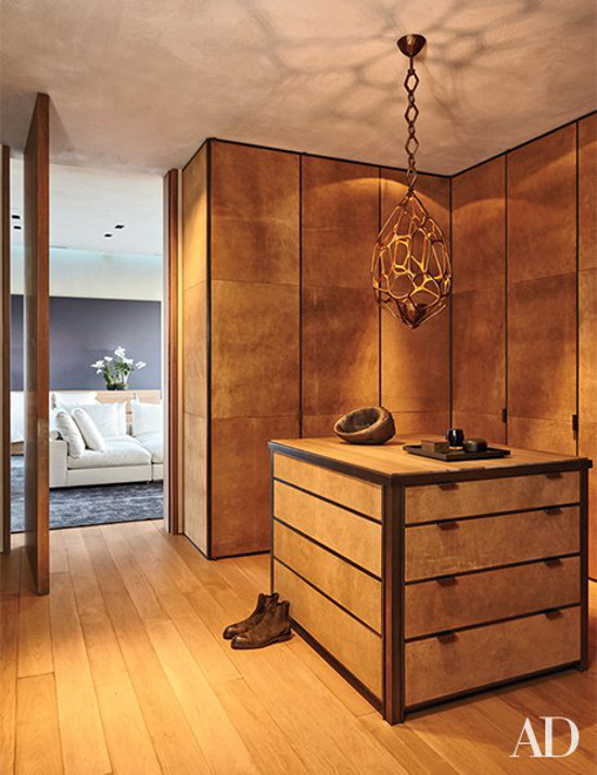 minimalist mansion - Michael Bay's wood paneled dressing room with a Herve van der Straeten pendant light - Architectural Digest via Atticmag