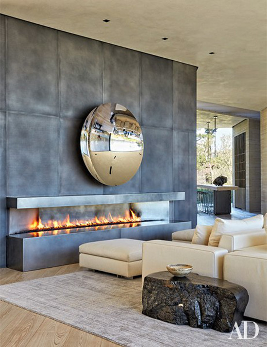 minimalist mansion - Steel panel fireplace in the living room of film maker Michael Bay's Bel Air modernist house - Architectural Digest via Atticmag