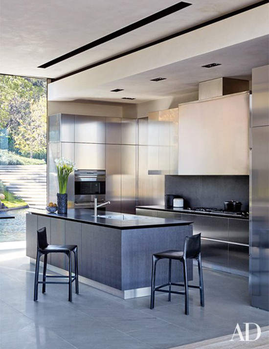 minimalist mansion - Boffi kitchen with Wolf appliances in film maker Michael Bay's L.A. home - Architectural Digest via Atticmag