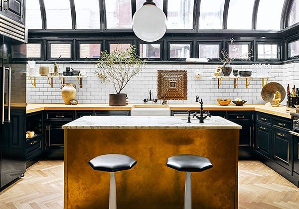 "greenhouse kitchen - ""after"" Nate Berkus and Jeremiah Brent's renovated NYC black and white penthouse kitchen - AD via Atticmag"