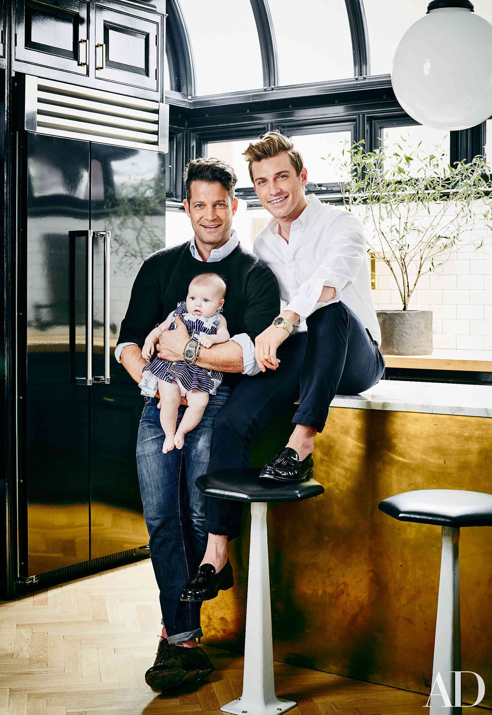 greenhouse kitchen - Designers Nate Berkus and Jeremiah Brent with their daughter Poppy in their renovated black and white NYC penthouse kitchen - AD via Atticmag