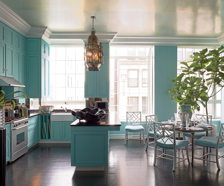 vibrant blue kitchen - Tiffany blue kitchen and dining room in a New York duplex by Thomas Britt - via Atticmag