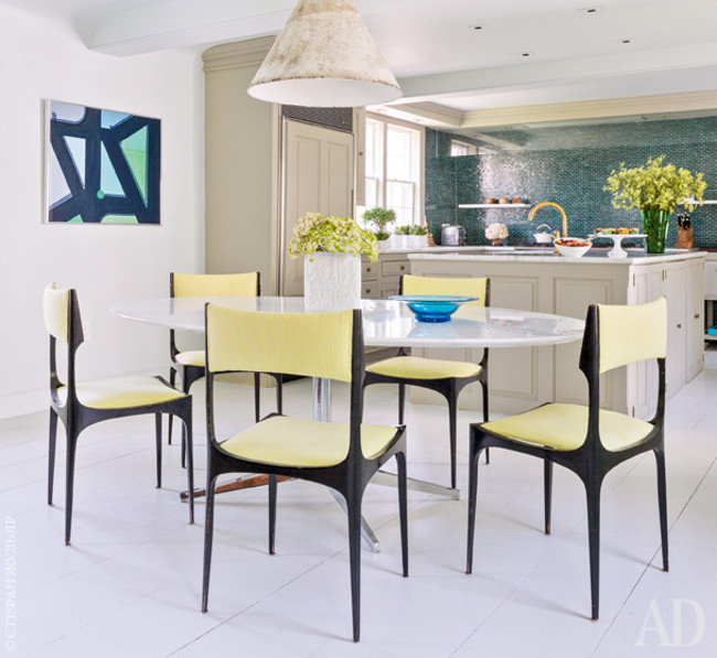 vibrant blue kitchens - Frank Roop's vibrant blue and green kitchen seen from the neutral dining room - AD via Atticmag