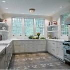 kitchen carpets - room size gray, white and charcoal modern carpet in a white and marble kitchen - M(Group) via Atticmag