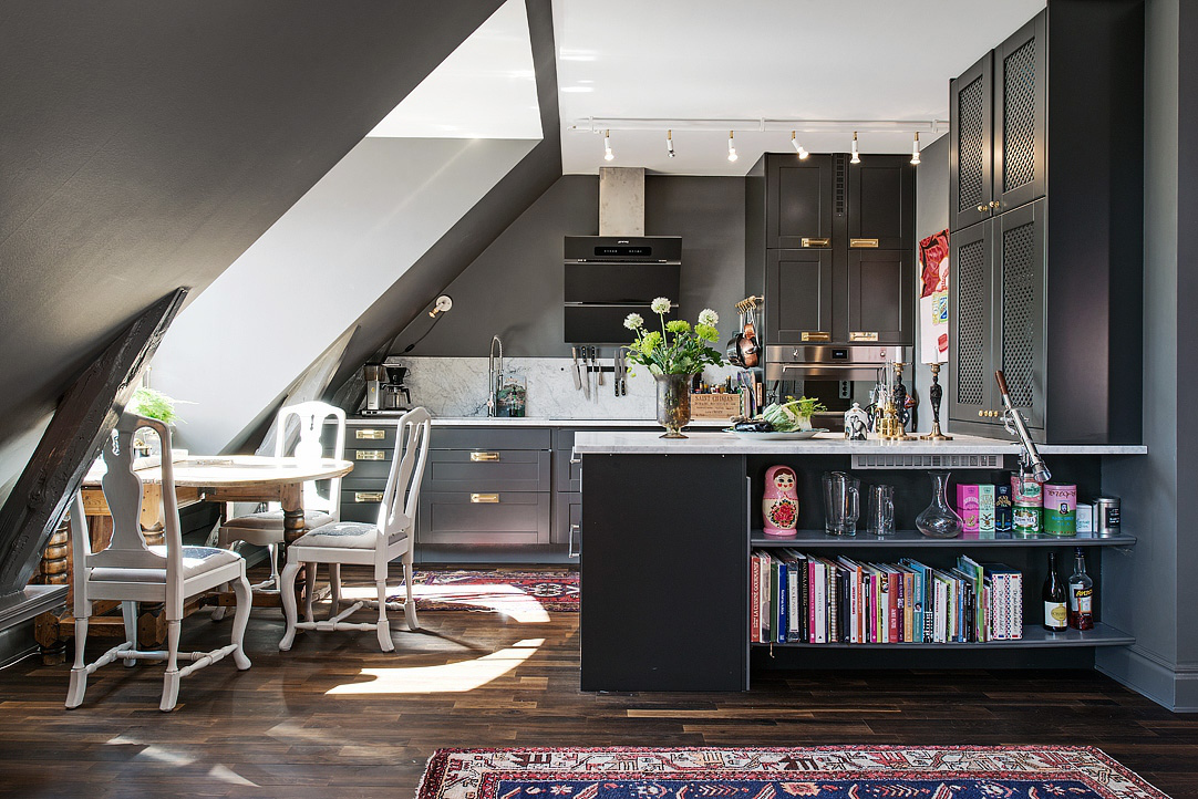 loft kitchen - dark gray open loft kitchen in a Swedish apartment is open to the living space - AlvhemMakleri.se via Atticmag