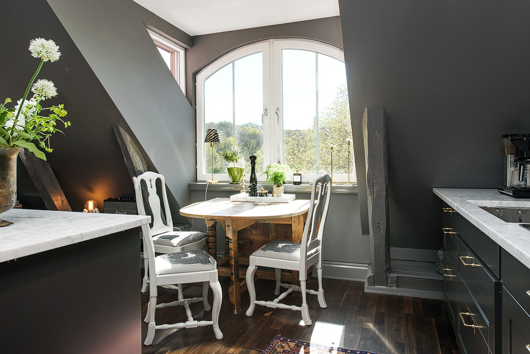 loft kitchen - antique Swedish drop leaf table against the dormer window - AlvhemMakleri.se via Atticmag