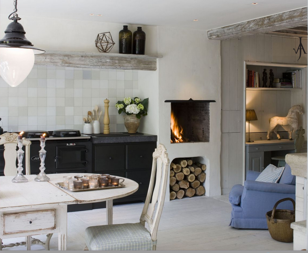 Belgian Kitchens   White Kitchen With Antique Swedish Dining Table,  Upholstered Armchair, Fireplace And