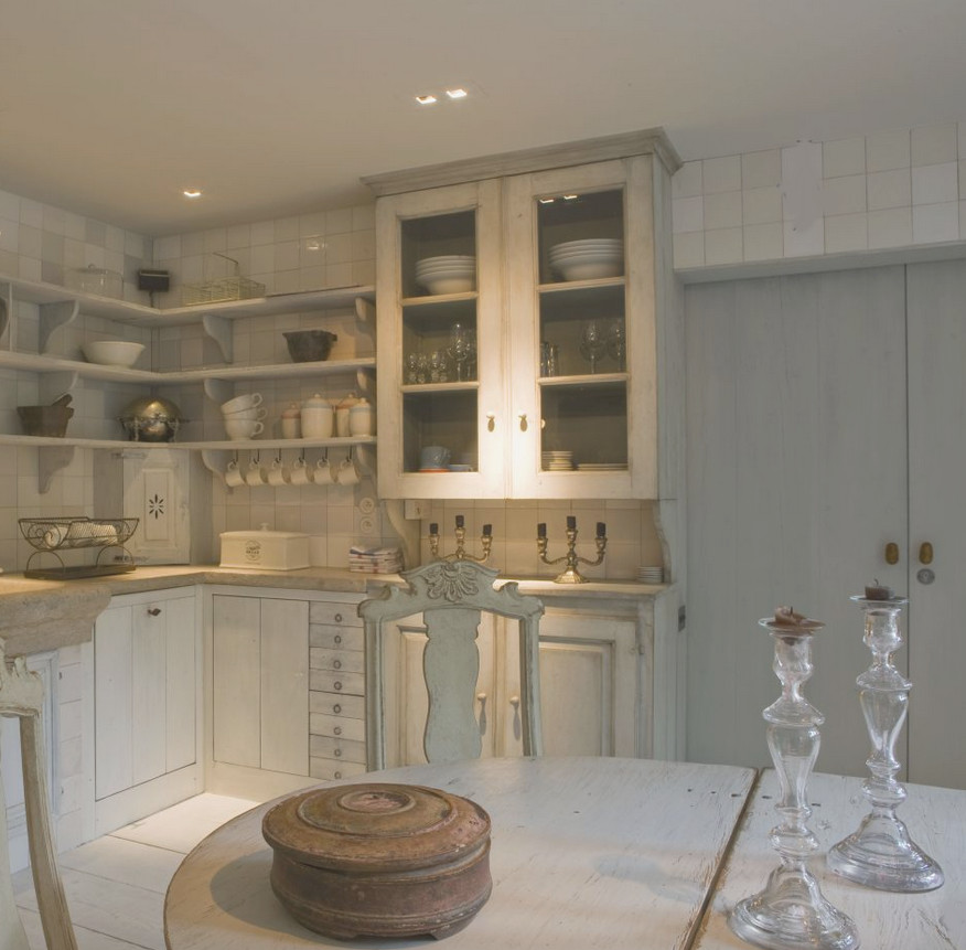 Belgian kitchens - non matching cabinets and a stone sink in a white-painted kitchen - Joris van Apers via Atticmag