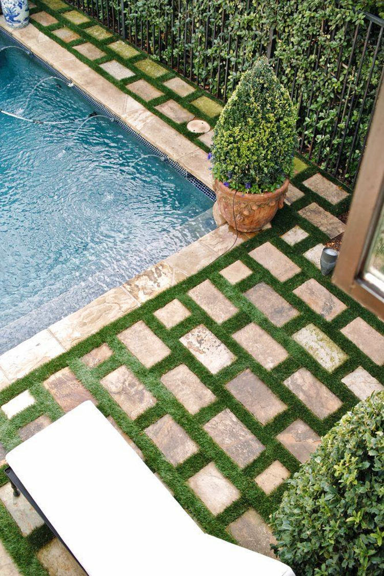 "outdoor home décor ideas - poolside pavers with grass ""grout"" - R&R Landscape via Atticmag"
