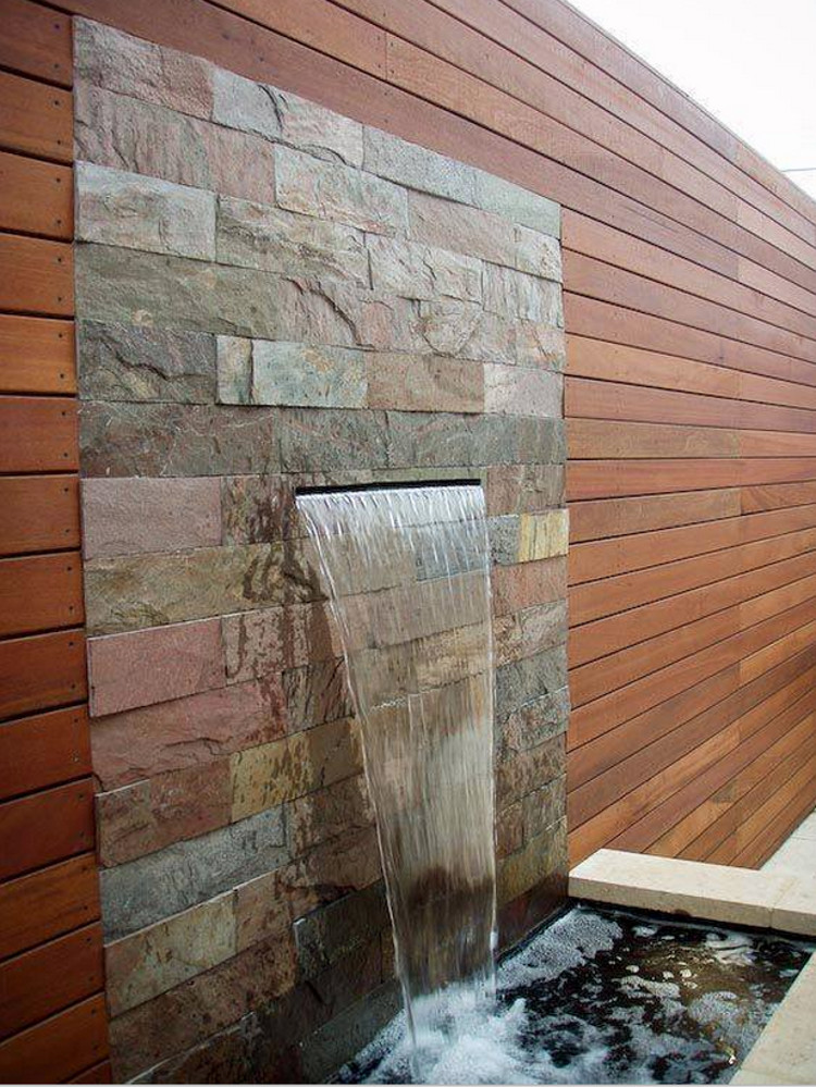 outdoor home décor ideas - modern stone and wood water wall - Unearthed Landscaping via Atticmag
