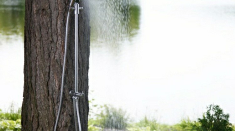basic outdoor shower with Riobel head and hand shower mounted on a tree - House&Home via Atticmag