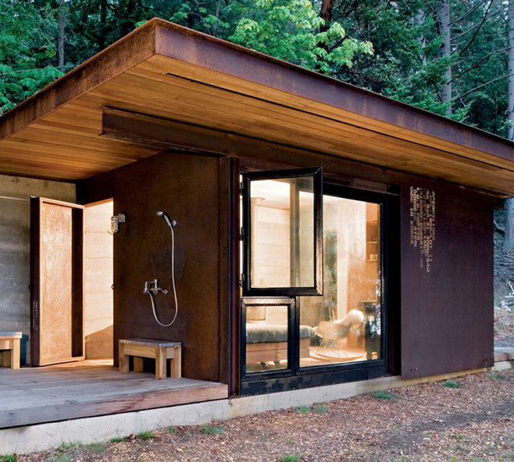 basic outdoor shower with hand shower and tub filler doubles as an outdoor bath for a Canadian cabin - Dwell via Atticmag