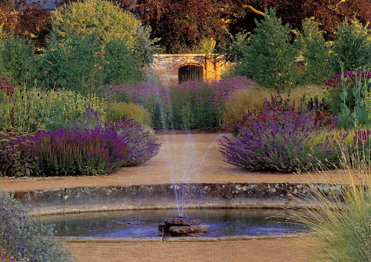 walled gardens - Perennial meadow oval fountain in the Scampston Walled Garden, Yorkshire, England - House & Garden via Atticmag