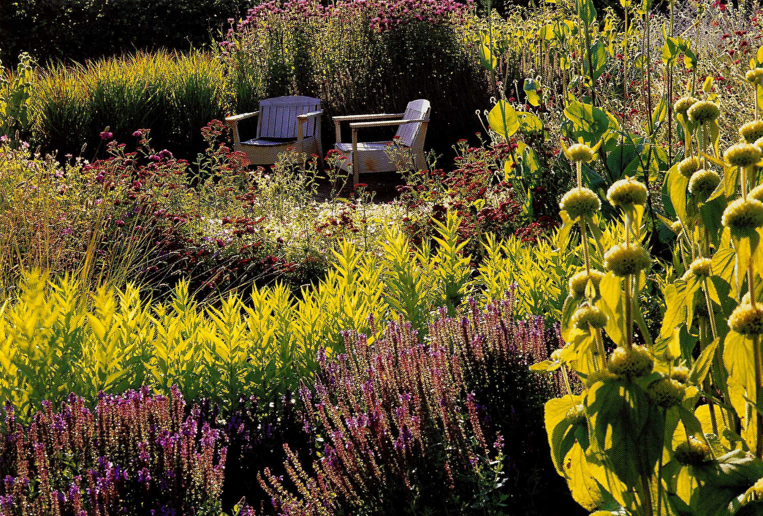 walled gardens - perennial meadow border of Scampston walled garden with low chair seating - House & Garden via Atticmag