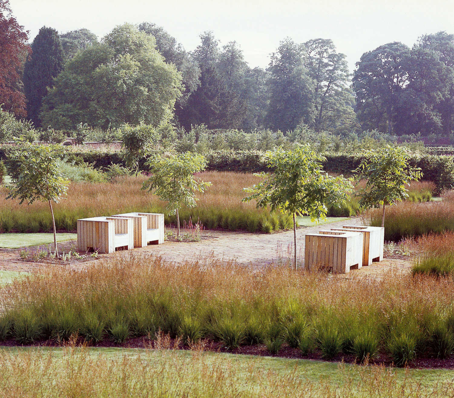 walled gardens - perennial moor grass planted in wavy beds in the Scampston walled garden - House & Garden via Atticmag