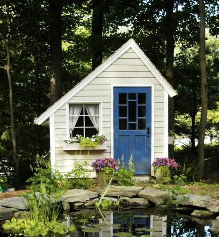 backyard shed - Small folly style cottage shed with blue door - Gardenweb via Atticmag
