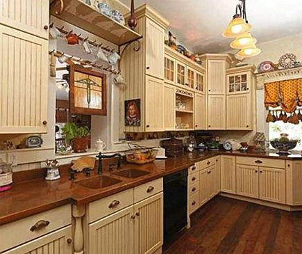 remodeled kitchen with copper counters in the Betty Crocker Estate, San Diego - Willis Allen Real Estate via Atticmag