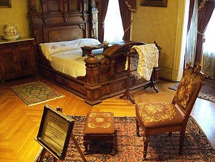 winchester house - bedroom with period furniture including an eastlake chair - via atticmag