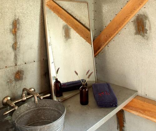 steel bucket bathroom sinks - steel bucket used as a sink on a polished concrete counter top - Studio Carver via Atticmg
