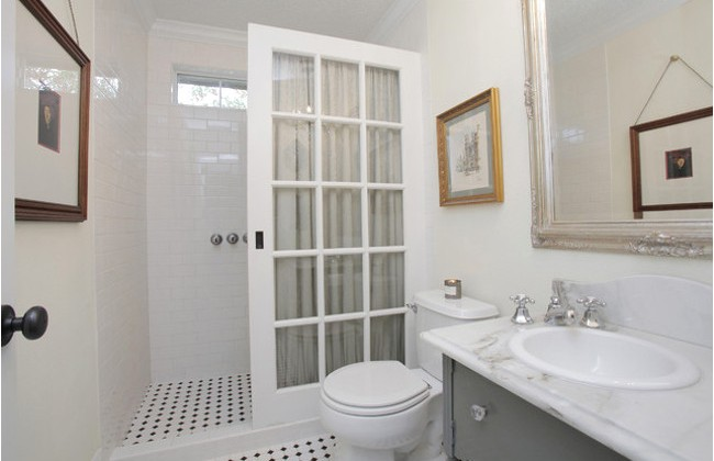 french door shower - bathroom shower partition created from a salvage french door - Brady and Tiffany Ross via Atticmag