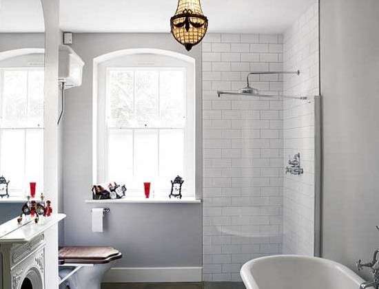 traditional bathroom fireplaces - vintage fireplace in a renovated European bath - housetohome via atticmag