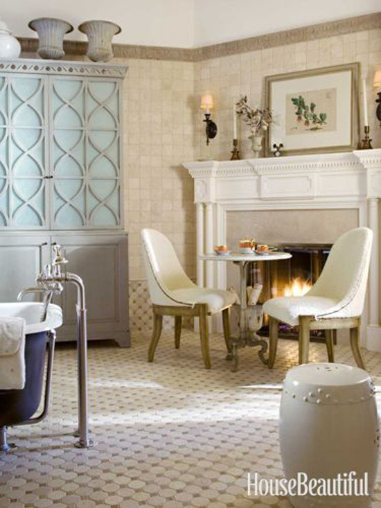 traditional bathroom fireplaces - tumbled marble Hollywood Regency style bath with working fireplace - housebeautiful via atticmag