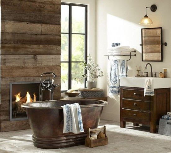traditional bathroom fireplaces - Fireplace in rustic wood-planked wall with copper top and dark wood vanity - pottery barn via atticmag