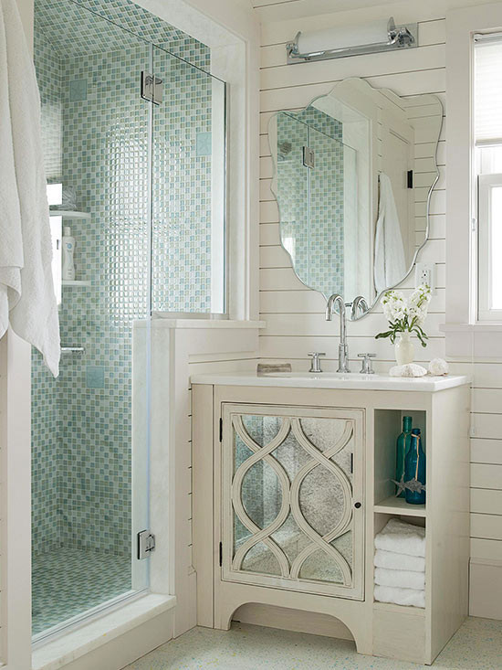 green bathrooms - variegated green mosaic tile shower sets the tone for a modern mix of styles in a small bath - Better Homes and Gardens via Atticmag