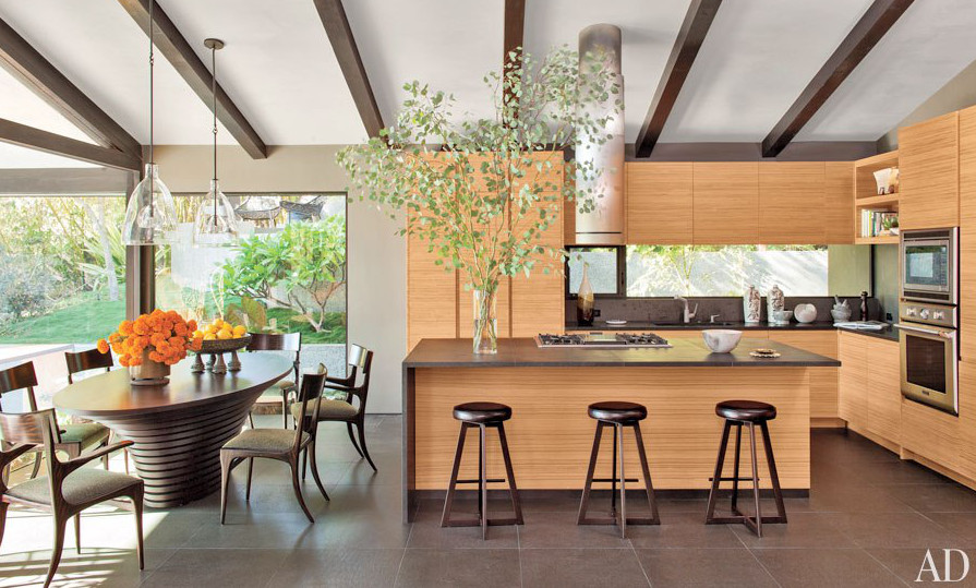 John Legend and Chrissy Teigen kitchens - LA kitchen with teak cabinets, basalt counters and Thermador appliances by Don Stewart of Desiderata Design - AD via Atticmag.com