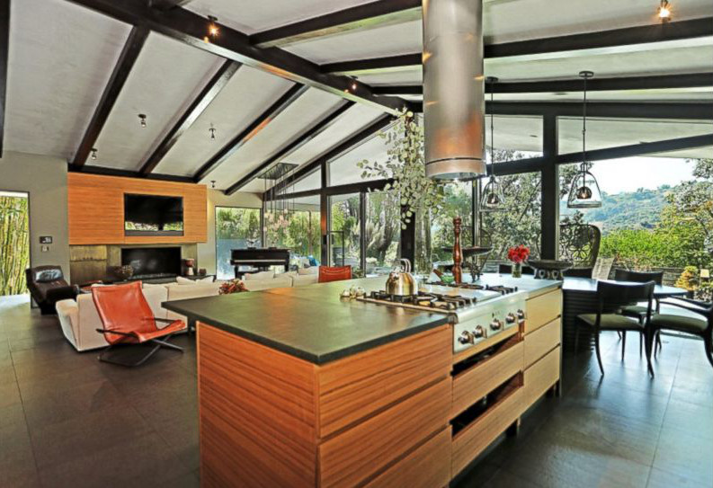 John Legend and Chrissy Teigen kitchens - Aisle side of LA kitchen with teak cabinets and basalt counters by Don Stewart of Desiderata Design - abcnews via Atticmag.com
