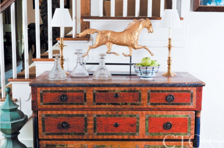collecting Americana - antique weathervane and decanters on a grain painted chest - Connecticut Cottages & Gardens via Atticmag