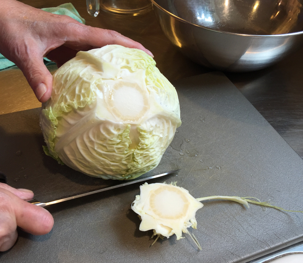 removing the tough stem from savoy cabbage for Thai Taste Cole Slaw - atticmag.com