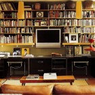 built in flat screen - combination home office & TV room with book shelves built around the flat screen - Elle Decor via Atticmag