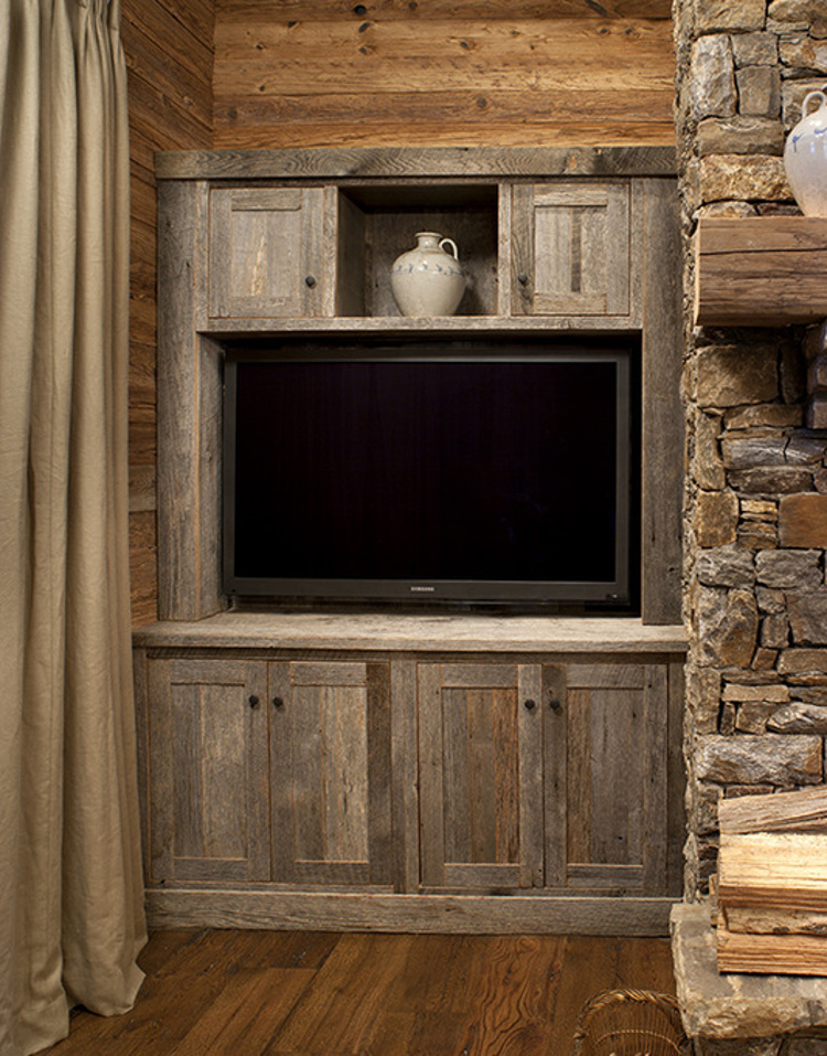 built in flat screen - Flat screen built into a barn wood cabinet next to a rustic fireplace - barnwoodcabinetcompany via Atticmag
