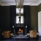 black room - all black room with fireplace and white trim by John Minshaw via Atticmag