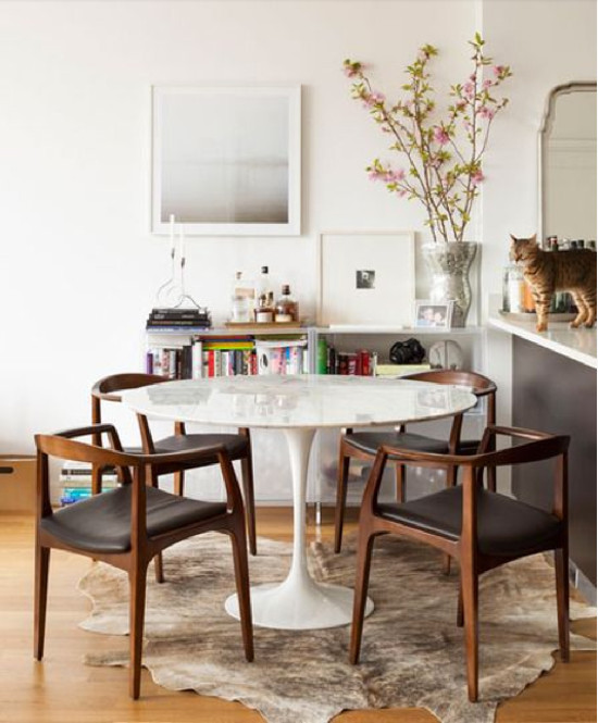designer furniture - Saarinen Round Dining Table 1956, with white base - apartmenttherapy via atticmag