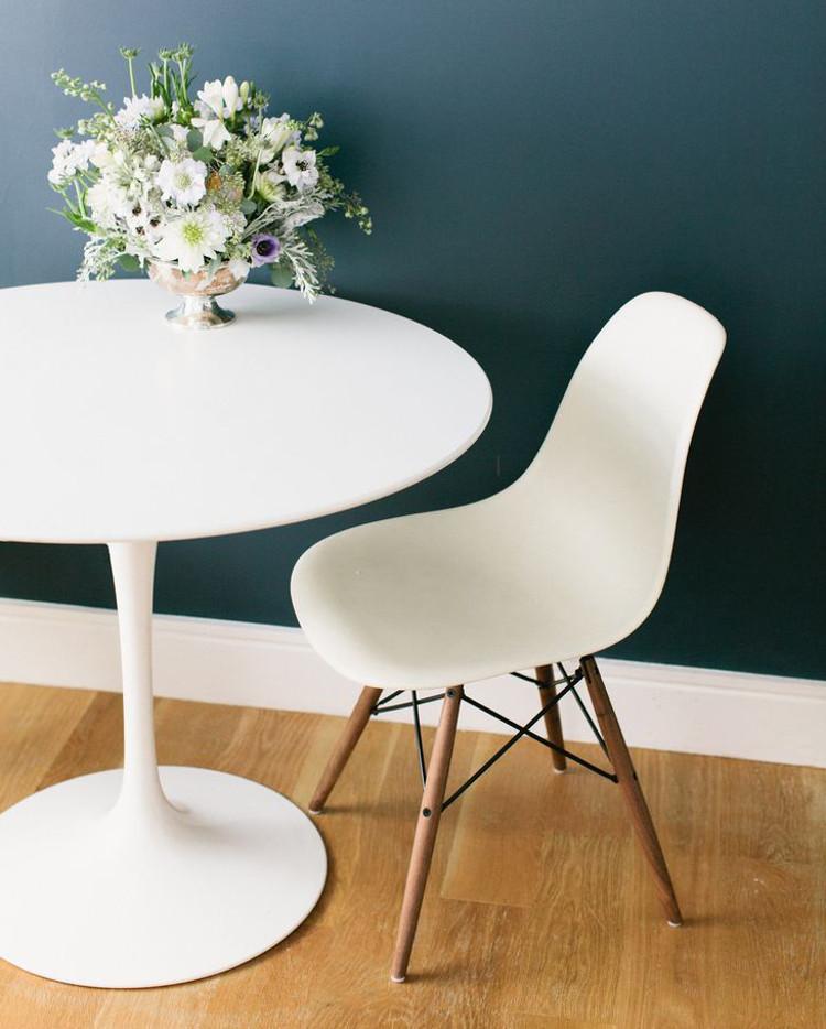 designer furniture - Eames molded plastic side chair in white, with dowel leg base, 1951 - ruemag via atticmag