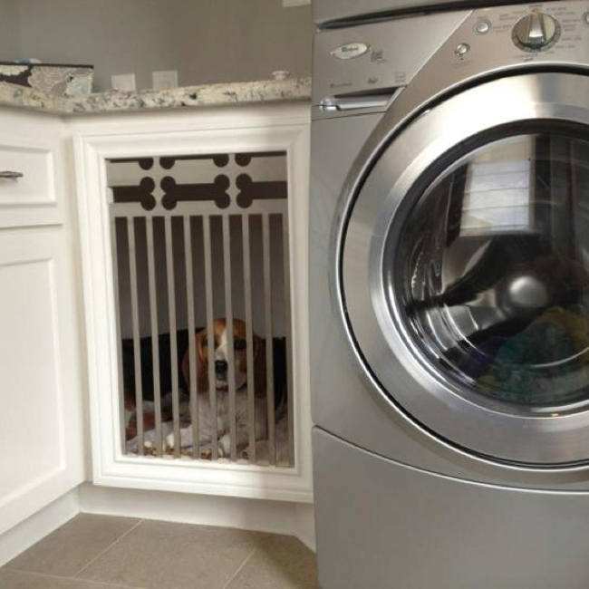 built in dog beds - laundry room dog bed with dog-bone motif metal grate on the door - pinterest via atticmag