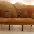 antique George III needlepoint sofa with asymmetrical back - WOI via atticmag