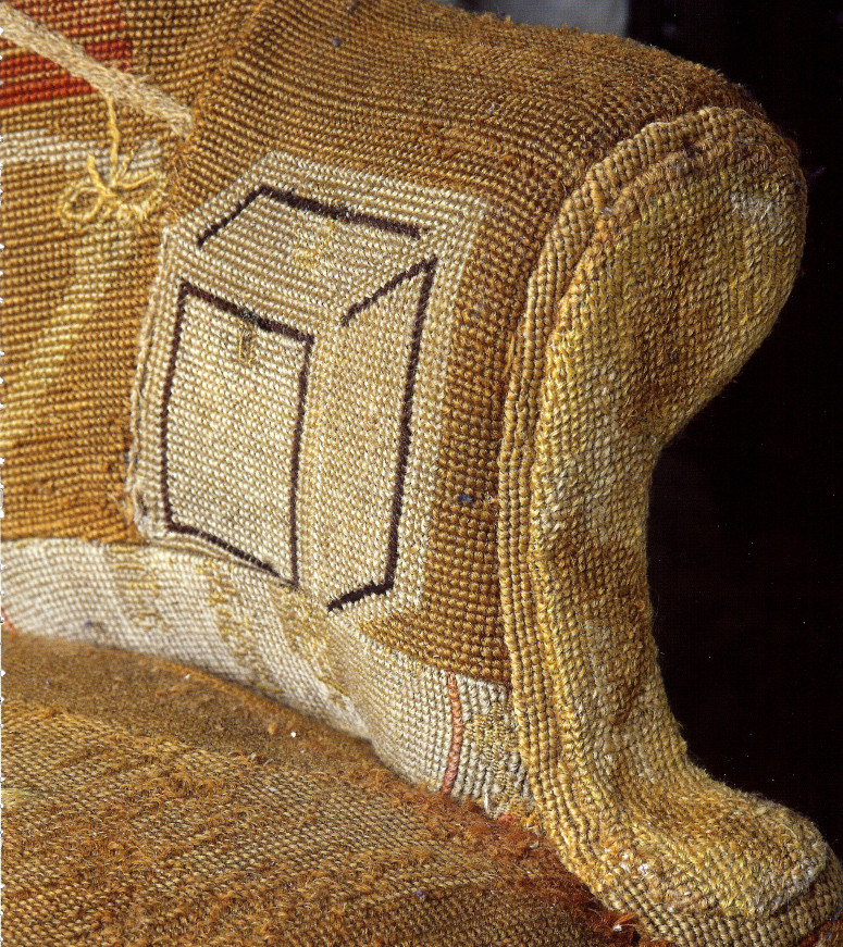 tea caddy detail of antique George III needlepoint sofa with asymmetrical back - WOI via atticmag