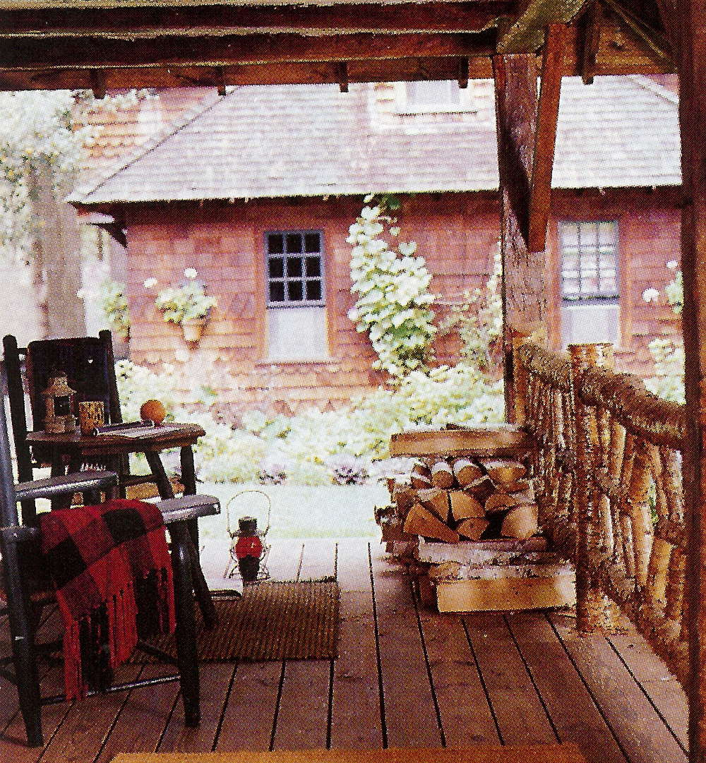 fishing camp - small porch with split-log railing - Country Living via Atticmag