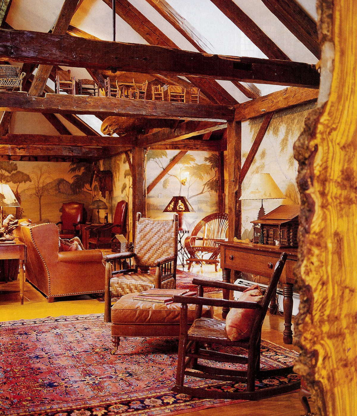 fishing camp - sitting room with rockers, leather sofa and faux-painted walls - Country Living via Atticmag