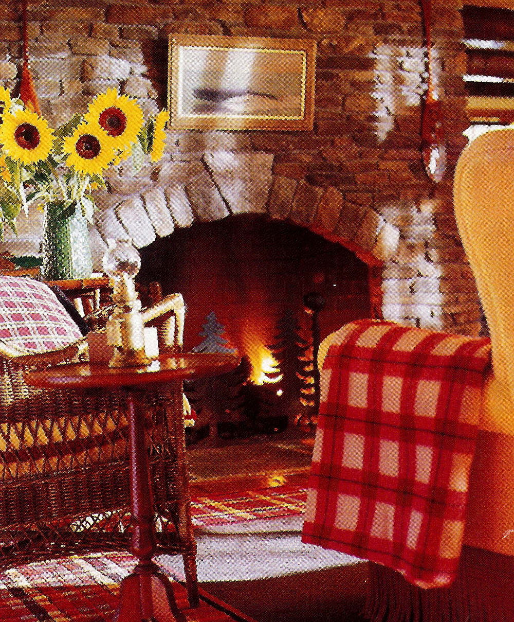 fishing camp - sitting room with traditional Adirondack stone fireplace - Country Living via Atticmag