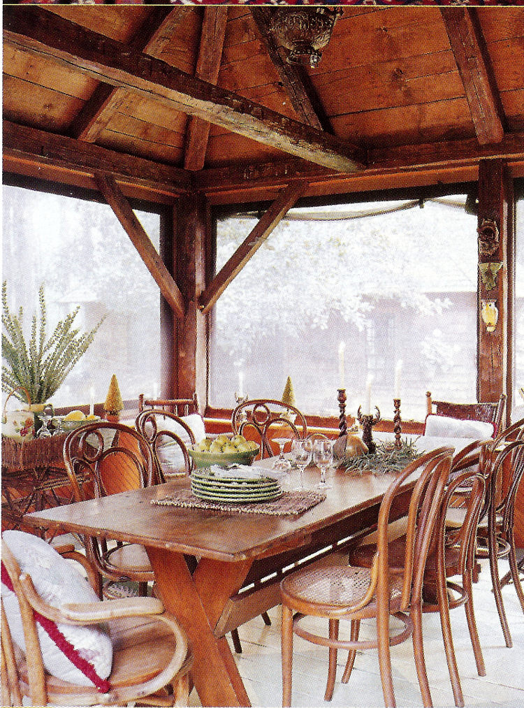fishing camp - screen porch dining table and bentwood chairs - Country Living via Atticmag
